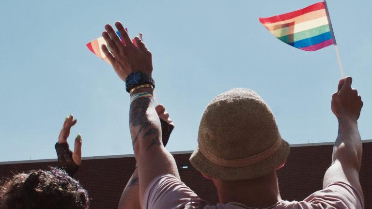 Protesters waving the rainbowflag